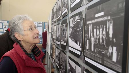 Jane Key takes a look at some of the old photographs. Picture: NIGE BROWN.