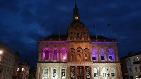 Ipswich Town Hall lit up in pink and blue to mark Baby Loss Awareness Week. Picture: IPSWICH BOROUGH