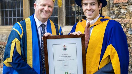Alex Dowsett with his honorary degree from Anglia Ruskin University, presented by vice-chancellor Pr