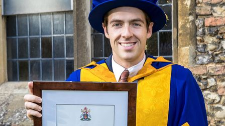 Essex cyclist Alex Dowsett with his honorary degree from Anglia Ruskin University. Picture: PAUL STA