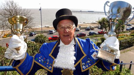 Ringing his bell - Felixstowe Town Crier Jimmy Wearne with his trophy for winning a town crier compe