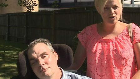 Simon Dobbin pictured with his wife, Nicole, outside Basildon Crown Court after 12 men were sentence
