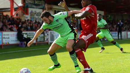 Drey Wright, in action on the opening day at Accrington Stanley, battling with Omar Beckles. Picture