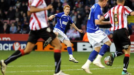 Jack Colback fires the ball across the penalty area at Sheffield during the second half