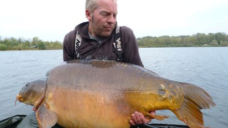 Nigel Ludbrook with the potentially record-breaking carp. Picture: CONTRIBUTED