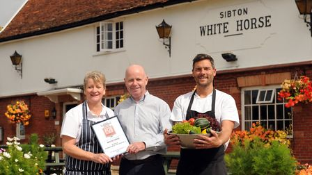 Sibton White Horse landlords Gill and Neil Mason, with chef Richard Grinyer, and the Good Pub Guide'