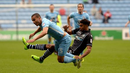 Mikael Mandron collides with Coventry defender Rod McDonald last weekend.