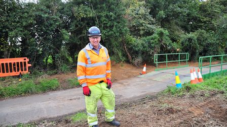 Work in Shingle Street to ensure badgers do no more damage to the road. Stephen Harrison at work on