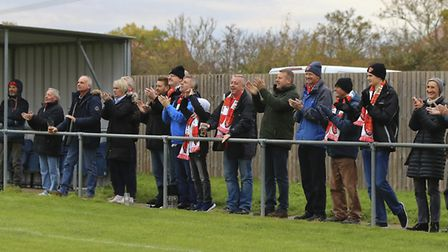 Travelling Felixstowe supporters cheer off their team at the final whistle at Godmanchester.