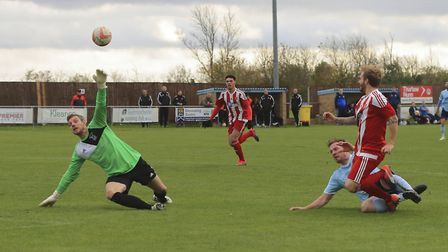 Scott Chaplin (right) slips the ball over Godmanchester 'keeper Phil Peachey to make it 0-2 for the
