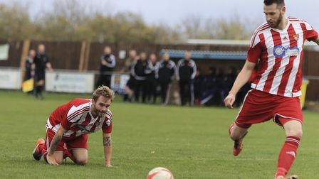 Scott Chaplin watches as Miles Powell strikes the ball to open the scoring for Felixstowe. Photo: ST