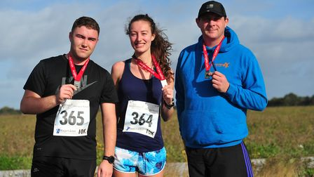 Joshua Griffiths, Francesca Lawton and Keelan Smith after the 10K. Picture: SARAH LUCY BROWN
