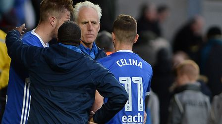 Mick McCarthy greets match-winner Bersant Celina after the final whistle at Burton Albion. Photo: Pa