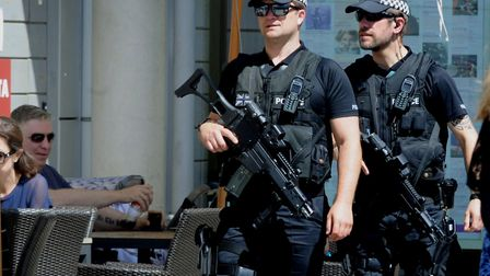 Armed police on patrol in Charter Square at the Arc Shopping Centre in Bury St Edmunds. Picture: AND