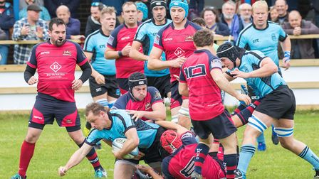 Woodbridge captain Tom Stokes is tackled in the draw with Wisbech. Picture: PAUL LEECH