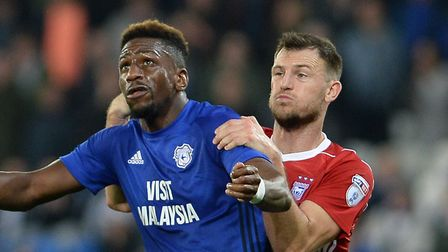 Tommy Smith, pictured battling with Cardiff's Omar Bogle for the ball, is in World Cup action. Pictu