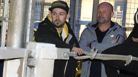 Danny King watches from the pits after crashing out of the knock-out cup final at Foxhall, with the