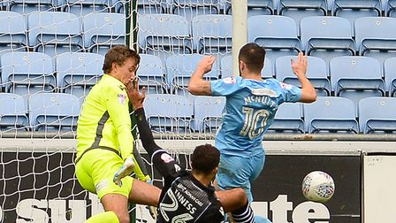Ryan Inniss makes a great interception as 10-man Colchester hold on for a point at the Ricoh Arena,