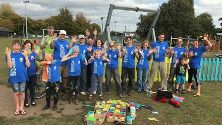 Volunteers painted a fence all the colours of the rainbow in Kingston Field, Woodbridge. Picture: CO