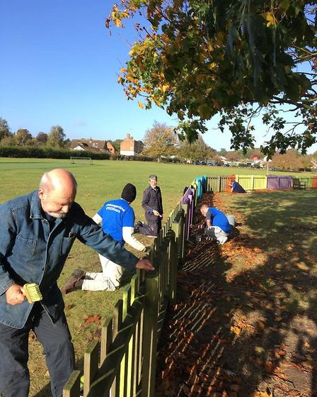 Volunteers painted a fence all the colours of the rainbow in Kingston Field, Woodbridge. Picture: DO
