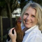 East Anglian food writer Tessa Allingham with one of her seven prized hens, whom she describes as a