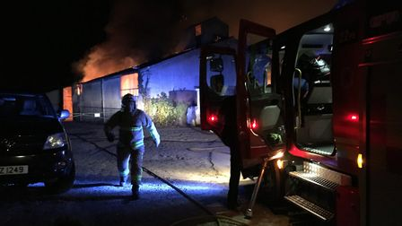 Firefighters tackling the barn blaze at Combs. Picture: TIAGO PERDIGAO