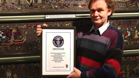 Michael Linton with the Guinness Award for the world's longest metal mosaic. Picture: MICHAEL LINTON