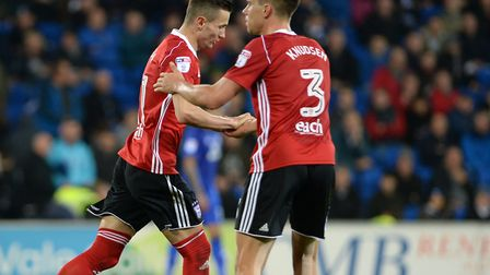 Bersant Celina is congratulated for scoring at Cardiff by Jonas Knudsen. Picture: PAGEPIX