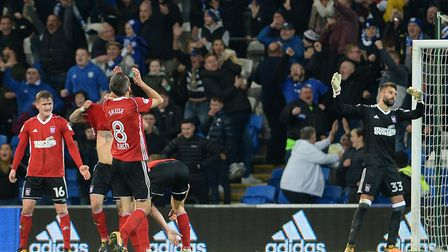 Ipswich players throw up their hands in despair as they concede a third goal at Cardiff last night.