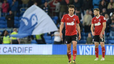 Bluebird flags fly as Town defenders Tommy Smith and Jonas Knudsen react to Cardiff's killer third g