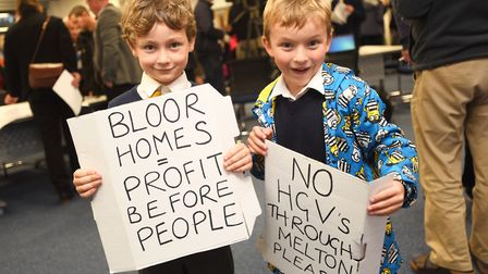 Louie Rudge-Buchanan (left) and Kit Cloughter protest against the housing development in Melton. Pic