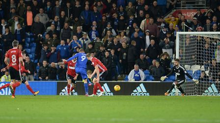 Danny Ward pounces to kill of any thought of an Ipswich comeback with Cardiff's third goal Picture P