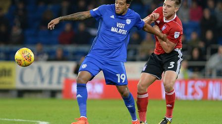Jonas Knudsen tries to get a grip on Nathaniel Mendez-Laing at Cardiff Picture Pagepix