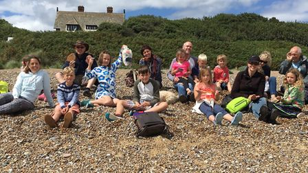 Participants in a Beach Bonkers beachcombing event on the Suffolk coast - Beach Bonkers is one of ei