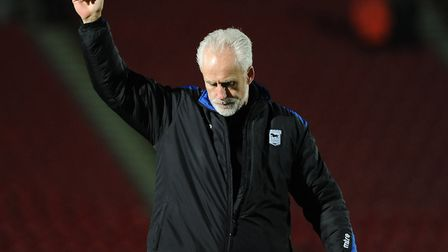 Mick McCarthy gives the travelling Ipswich supporters a thumbs up at Doncaster on Boxing Day 2013. P