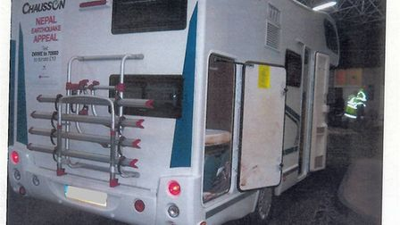 An adult couple and two children were discovered in the back of the camper van hiding under a sheet.