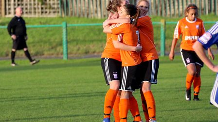 Cassie Craddock and Amanda Crump celebrates with goalscorer Zoe Cossey as Town make it 2-1 against A