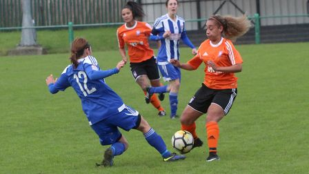 Zoe Cossey at the double as she celebrates with Cassie Craddock. Picture: ROSS HALLS