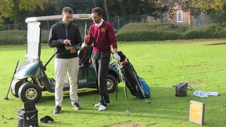 Suffolk county coach Joe Cardy checks the Trackman readings with Adam Sheldrake after a session at H
