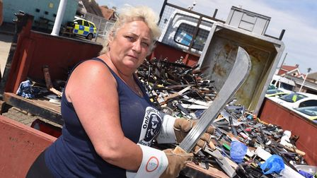 Only Cowards Carry founder Caroline Shearer emptying out the Clacton knife amnesty bins at the local