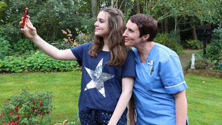 Hope Drew takes a pyjama selfie with her mum Janine Drew, who is also a care assistant on the hospic
