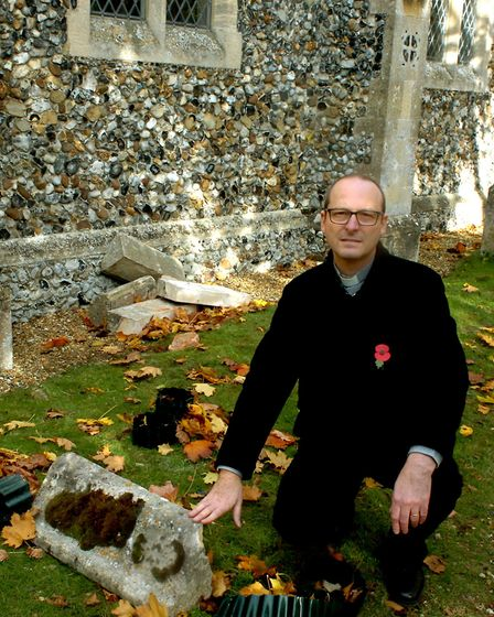 The Rev Peter Goodridge at St John's Church in Elmswell where thieves have stripped the lead of the