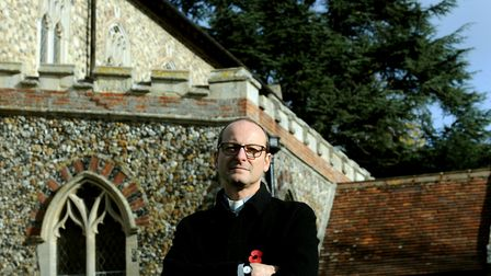 The Rev Peter Goodridge at St John's Church in Elmswell where theives have stripped the lead of the