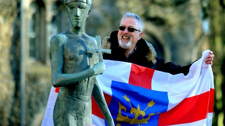 James Sheen proudly sports the flag of St Edmund at the launch of the Your Town Needs You campaign i