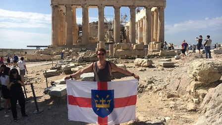 Brian Gobey flies the flag in Athens. PICTURE: We Love Bury St Edmunds
