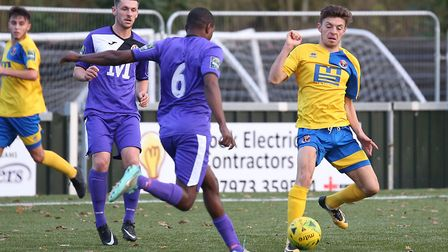 Sudbury's Max Booth, right,, in action for the west Suffolk club against Tilbury on Saturday.