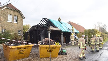 Firefighters at the scene of a farmhouse fire near Stoke by Clare. Picture: GREGG BROWN