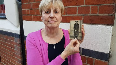 Diane Bayliss, from hadleigh, with a photo of her uncle Private Raymond Suttle who is buried in the