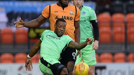 Barnet left wing-back David Tortonda is beaten to the ball by Ryan Jackson during this afternoon's L