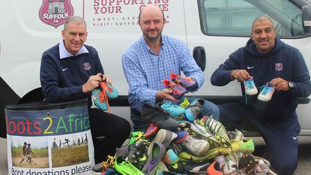 Iain Finch of Boots2Africa, centre, pictured with Suffolk FA staff, Nick Garnham, left, and Darren S